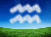 Cloud in shape of aquarius star sign — Stock Photo