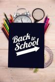 Composite image of back to school message with arrow — Stock Photo