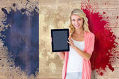 Student showing tablet against france flag — Stockfoto