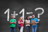 Pupils against wall with math question — Stock Photo