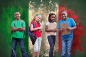 Cute pupils against italy flag — Stock Photo