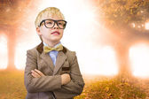 Pupil dressed up as teacher against trees — Stockfoto
