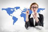 Businesswoman against blue world map — Stok fotoğraf