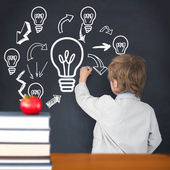 Composite image of cute pupil writing on board — Stock Photo