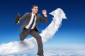 Cheerful businessman with briefcase — Stock Photo