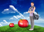 Student holding books and bag — Stockfoto