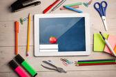 Digital tablet on students desk — Stock Photo