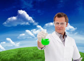 Scientist working with beaker — Foto de Stock