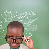 Pupil tilting glasses against arrows — Stock Photo
