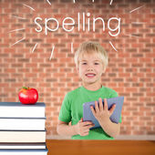Spelling against red apple on pile of books — Stock Photo