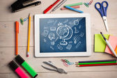Digital tablet on students desk — Stockfoto