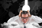 Stressed businessman touching his head — Stock Photo