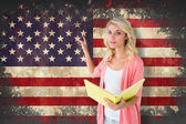 Student reading against usa flag — Stock Photo