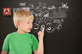 Boy pointing against wooden blocks — Stock Photo