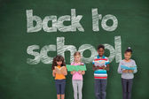 Pupils  with back to school message — Stock Photo