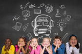 Pupils against wall with school doodles — Stock Photo