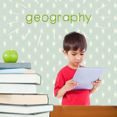 Geography against red apple on pile of books — Stock Photo
