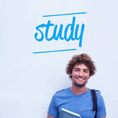 Study against happy student holding book — Foto Stock