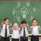 Idea and innovation graphic against pupils — Stock Photo