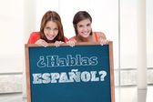 Teenage girls holding blank poster — Stockfoto