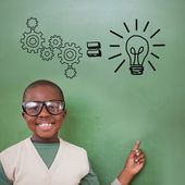 Pupil pointing against idea graphic — Stock Photo