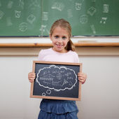 Cute pupil showing chalkboard — Stok fotoğraf