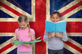 Pupils reading against union jack flag — Stock Photo
