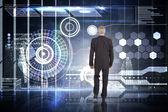 Businessman walking against hologram interface — Stock Photo