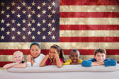 Cute pupils against usa flag — Stock Photo