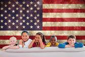 Cute pupils against usa flag — Stock Photo