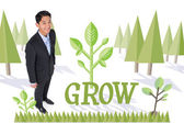 Word grow and smiling asian businessman — Stock Photo