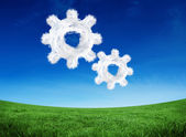 Composite image of cloud cog and wheel — Stock Photo