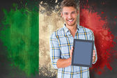 Student showing tablet against italy flag — Stock Photo