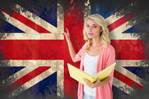 Student pointing against union jack flag — Stock Photo