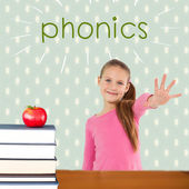 Phonics against red apple on pile of books — Stock Photo