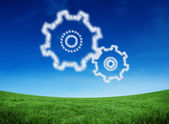 Cloud in shape of cogs and wheels — Stock Photo