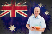 Student holding notebooks against australia flag — Stock Photo