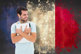 Student holding laptop against france flag — Stockfoto