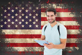 Student using tablet pc against usa flag — Stock Photo