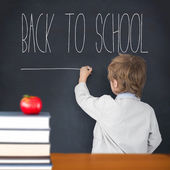 Pupil writing on board — Stock Photo