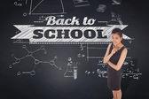 Thoughtful businesswoman against blackboard — Stock Photo