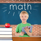 Math against red apple on pile of books in classroom — Stockfoto