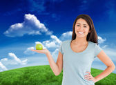 Student holding green apple — Stock Photo