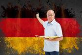 Teacher pointing against germany flag — Stock Photo