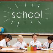 Word school against cute pupils — Stock Photo