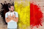 Student holding laptop against belgium flag — Stock Photo