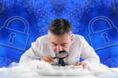 Businessman examining with magnifying glass — ストック写真