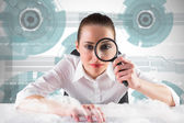 Businesswoman looking through magnifying glass — Stock Photo