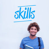 Skills against happy student holding book — Stock Photo