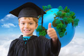 Cute pupil in graduation robe — Stock Photo